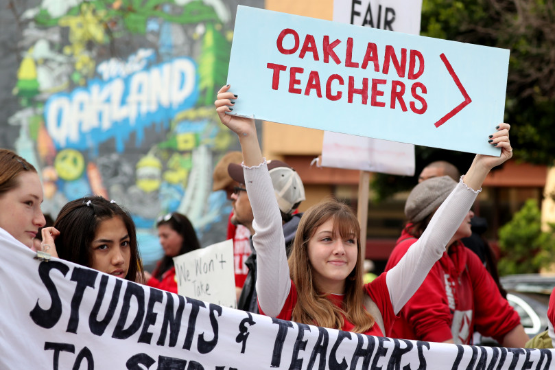 Teachers, students, and parents walk the picket line