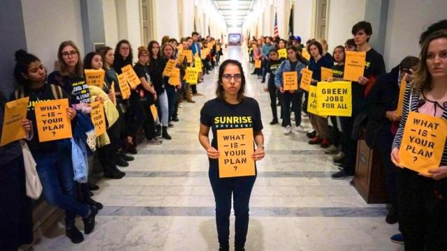 Sunrise Movement, climate policy, climate crisis, carbon emissions, Green New Deal, Alexandria Ocasio-Cortez, Nancy Pelosi, Democratic leadership, Democratic National Committee, green jobs, renewable energy economy