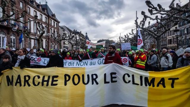 Demonstrators at the 'March for Climate' rally in the eastern French city of Strasbourg (AFP/PATRICK HERTZOG)